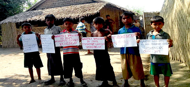 Young Rohingya children hold placard to welcome census processing group