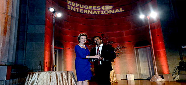 Rohingya activist and BROUK President Tun Khin receiving Richard C Holbrook Leadership Award